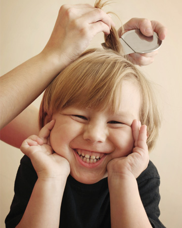 Little boy having lice treatment