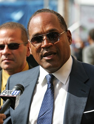 OJ Simpson talks to reporters in 2005