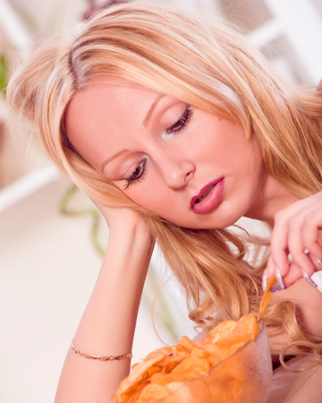 Sad woman eating chips