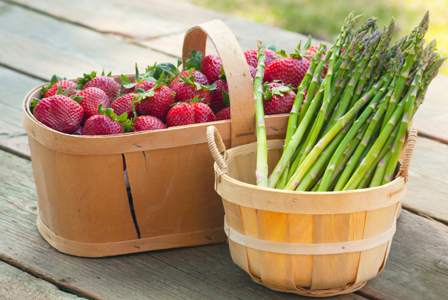 Strawberries and asparagus in baskets