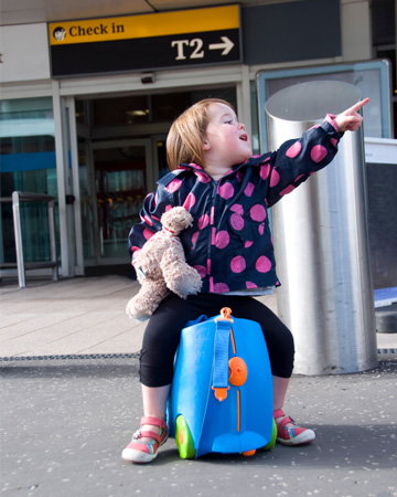 Toddler girl at airport