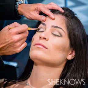 Makeup artist using makeup brush