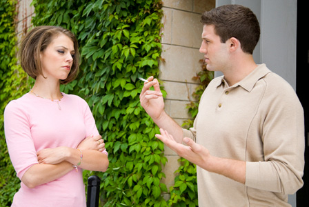 Woman annoyed with smoking boyfriend