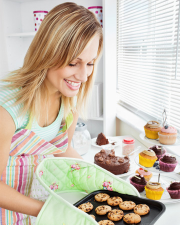 Woman baking cookies and cupcakes