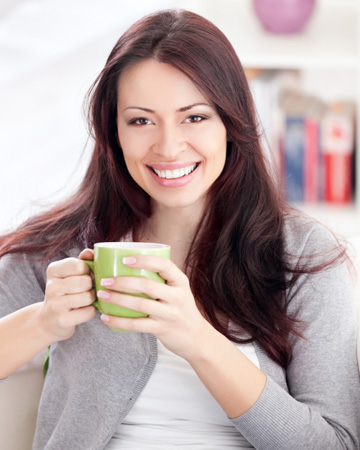 Woman drinking grean tea