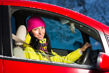 woman driving in snow