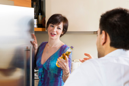 Woman getting beer for man