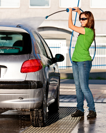 Woman washing her car