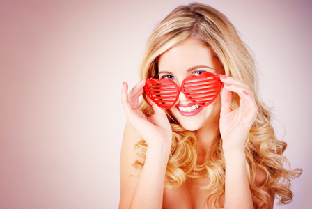 Woman wearing heart shaped glasses