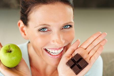 Woman with apple and chocolate