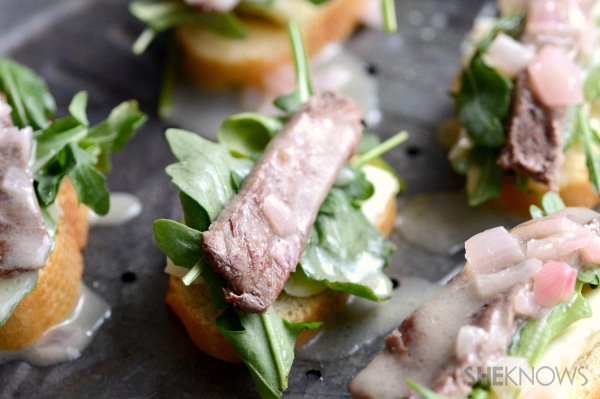 Steak crostinis with champagne butter sauce