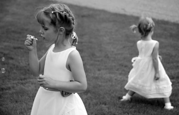 Girls blowing bubbles at a wedding