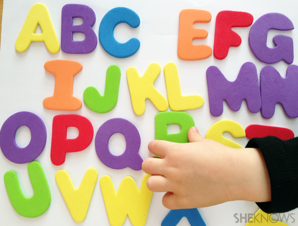 Learning to spell their name and count foam letters and numbers