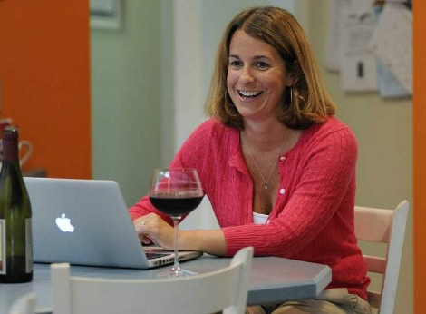 Marile Borden with wine and laptop