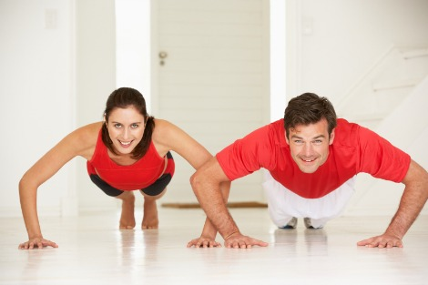 Couple working out at home