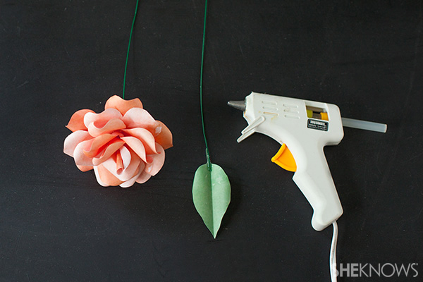 Create a natural looking rose, and glue a leaf to a floral wire