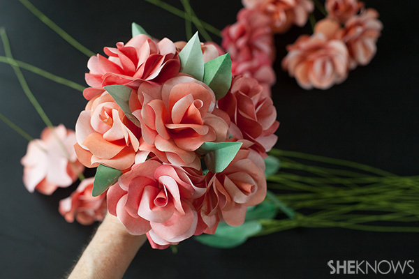 Start assembling the paper roses and leaves into a bridal bouquet