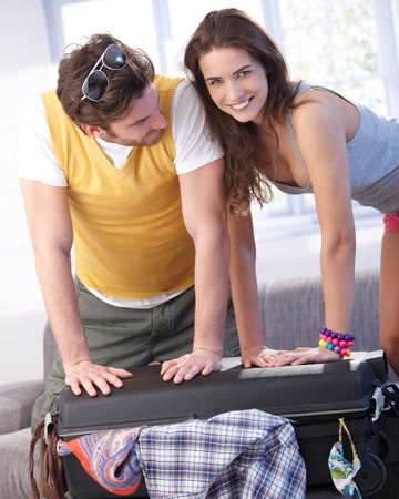 Couple packing for vacation
