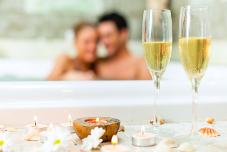 Couple in tub with champagne