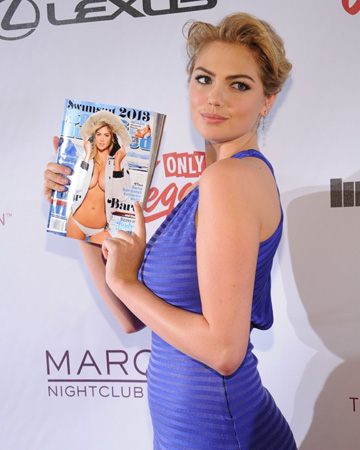 Kate Upton holding Sports Illustrated Swimsuit Edition