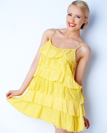 Happy woman in yellow dress