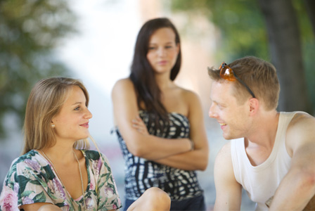 Jealous woman looking at couple