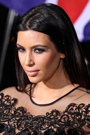 Kim Kardashian gets blood on her face