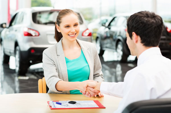Woman making a deal on a car