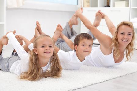 Mom doing yoga with kids