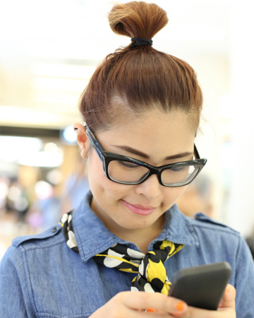 Trendy woman on iphone