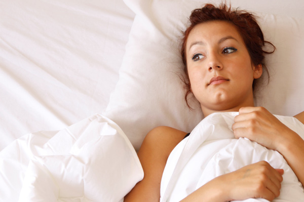 unhappy woman in bed