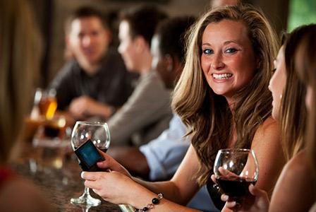 woman text messaging at the bar