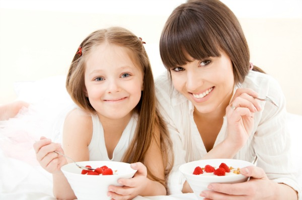 Mom and daughter eating yogurt