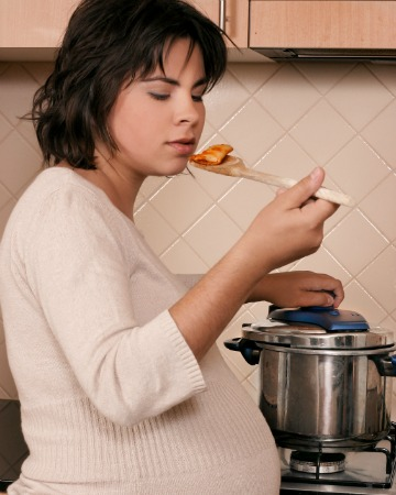 Pregnant woman eating pasta