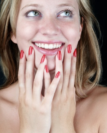 Blonde with red manicure