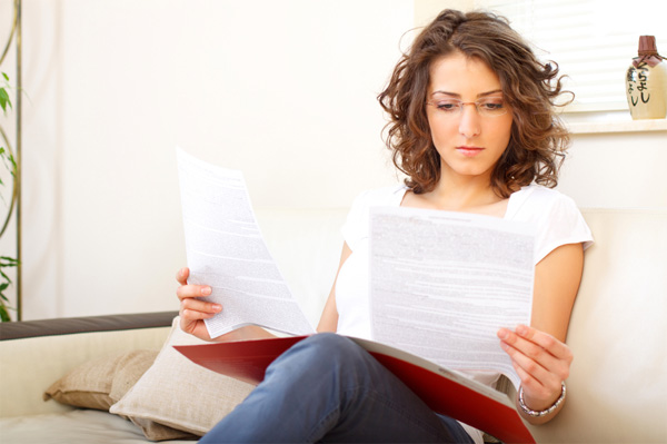 Woman going over paperwork