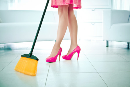 Woman sweeping tile floor