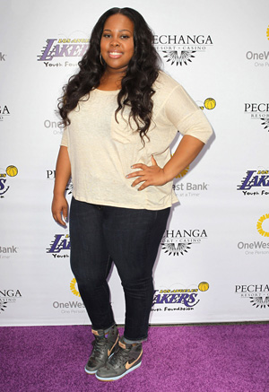 Amber Riley wearing skinny jeans
