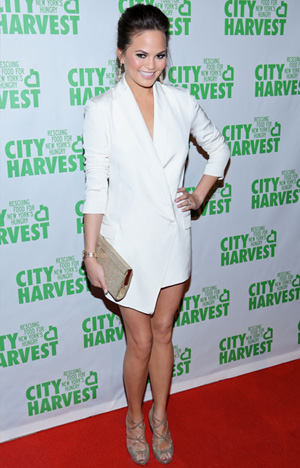 Chrissy Teigen wearing white blazer