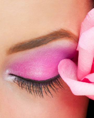 Girl with pink eye shadow and flower