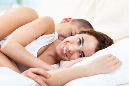 Man spooning woman after sex