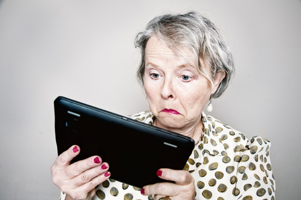 Senior woman confused by tablet