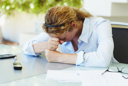Stressed woman at work
