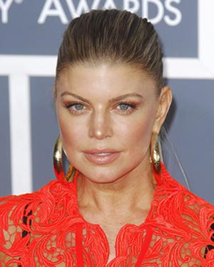 Fergie wearing bright orange eye makeup