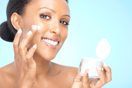 Woman applying beauty cream