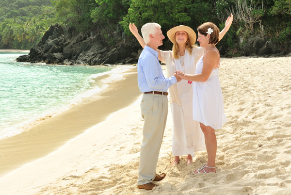 Woman officiating beach wedding