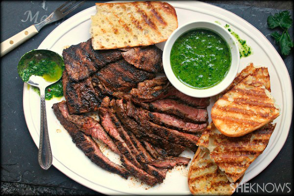 Grilled flat iron steak with chimichurri sauce and grilled bread
