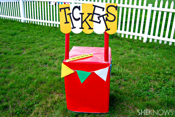 Create an outdoor kids' carnival with cardboard boxes