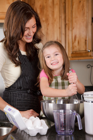 Happy mom in kitchen with daughter