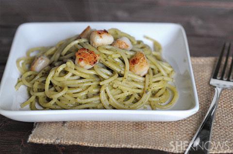 Seared scallops over pasta with avocado pesto